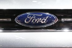 The company logo is seen on the bonnet of a Ford car during the media day ahead of the 84th Geneva Motor Show at the Palexpo Arena in Geneva March 5, 2014.  REUTERS/Arnd Wiegmann