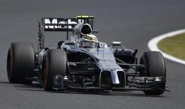 McLaren Formula One driver Kevin Magnussen of Denmark drives during the first practice session of the Japanese F1 Grand Prix at the Suzuka Circuit October 3, 2014.  REUTERS/Yuya Shino