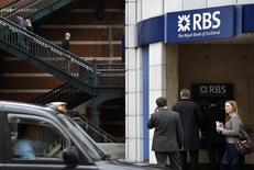 People pass a branch of The Royal Bank of Scotland (RBS) in central London August 27, 2014. REUTERS/Toby Melville