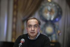 Sergio Marchionne, chief executive officer of Fiat Chrysler Automobiles, speaks with the media before ringing the closing bell to celebrate the company's listing at the New York Stock Exchange, October 13, 2014. REUTERS/Eduardo Munoz