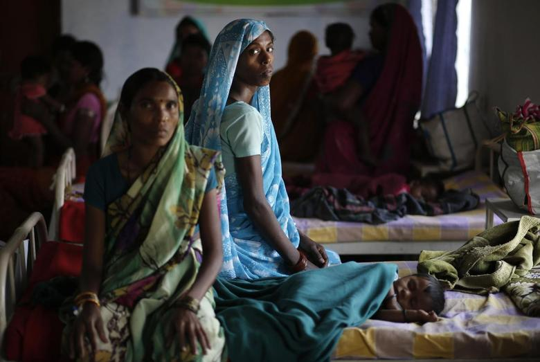 Kekti Bai (C), who underwent a sterilisation surgery at a government mass sterilisation camp, watches while other women sit inside a hospital at Bilaspur district in Chhattisgarh November 15, 2014. REUTERS/Anindito Mukherjee