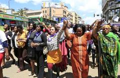 Women take part in a protest along a main street in the Kenyan capital of Nairobi November 17, 2014. REUTERS/Noor Khamis