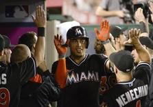 Aug 25, 2014; Anaheim, CA, USA; Miami Marlins right fielder Giancarlo Stanton (27) celebrates with teammates after hitting a three-run home run during the fourth inning against the Los Angeles Angels at Angel Stadium of Anaheim. Mandatory Credit: Richard Mackson-USA TODAY Sports