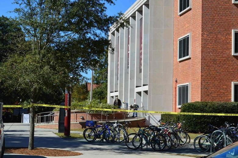 Crime scene tape is seen in front of the library at Florida State University, in Tallahassee, Florida, November 20, 2014. REUTERS/Bil Cotterell