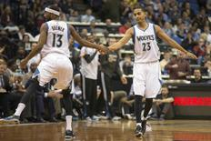 Nov 19, 2014; Minneapolis, MN, USA; Minnesota Timberwolves guard Kevin Martin (23) celebrates with guard Corey Brewer (13) after scoring in the second half against the New York Knicks at Target Center. The Timberwolves won 115-99. Mandatory Credit: Jesse Johnson-USA TODAY Sports