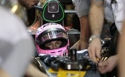 McLaren Formula One driver Jenson Button of Britain sits in his car during the second practice session of the Abu Dhabi F1 Grand Prix at the Yas Marina circuit in Abu Dhabi November 21, 2014. REUTERS/Caren Firouz