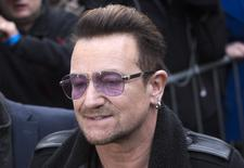U2 lead singer Bono arrives for the recording of the Band Aid 30 charity single in west London November 15, 2014. REUTERS/Neil Hall