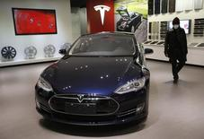 A man looks at Tesla Motors' Model S P85 at its showroom in Beijing January 29, 2014. REUTERS/Kim Kyung-Hoon