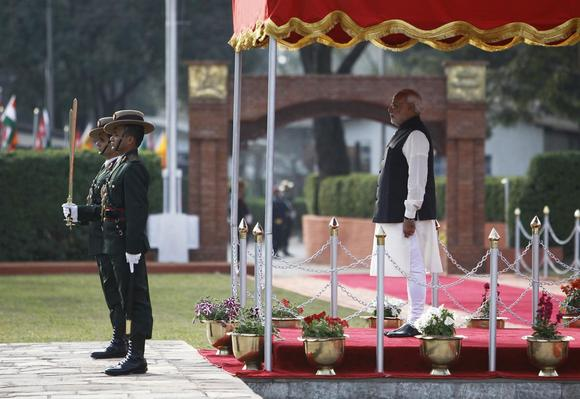 Prime Minister Narendra Modi watches a guard of honour upon his arrival for the 18th South Asian Association for Regional Cooperation (SAARC) summit in Kathmandu November 25, 2014. REUTERS/Navesh Chitrakar