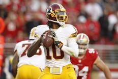 Nov 23, 2014; Santa Clara, CA, USA; Washington Redskins quarterback Robert Griffin III (10) looks to throw a pass against the San Francisco 49ers in the fourth quarter at Levi's Stadium. The 49ers defeated the Redskins 17-13. Mandatory Credit: Cary Edmondson-USA TODAY Sports