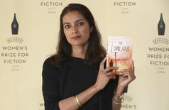 "Author Jhumpa Lahiri poses with her novel ""The Lowland"", ahead of the 2014 Bailey's Women's Prize for Fiction in London June 4, 2014. REUTERS/Neil Hall"