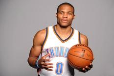 Sep 29, 2014; Oklahoma City, OK, USA; Oklahoma City Thunder guard Russell Westbrook (0) poses during media day at Chesapeake Energy Arena. Mandatory Credit: Mark D. Smith-USA TODAY Sports