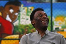 Brazilian soccer legend Pele laughs during the inauguration of a refurbished soccer field at the Mineira slum in Rio de Janeiro September 10, 2014. REUTERS/Ricardo Moraes