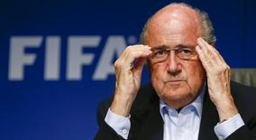 FIFA President Sepp Blatter adjusts his glasses as he addresses a news conference after a meeting of the FIFA executive committee in Zurich September 26, 2014. Reuters/Arnd Wiegmann/Files