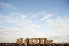 People attend the annual summer solstice at the Stonehenge monument on Salisbury Plain in Wiltshire, southern England June 21, 2010. REUTERS/Kieran Doherty