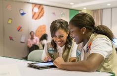 Girl Scouts practice placing orders using Digital Cookie, a new addition to the Girl Scout Cookie Program. in this undated handout picture. REUTERS/Girl Scouts of the USA