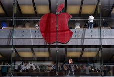 The Apple logo on display at the Sydney Apple Store is illuminated in red to mark World AIDS Day, in Sydney December 1, 2014. REUTERS/David Gray