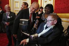 Britain's Prince Philip meets Stephen Hawking (R) during a reception for Leonard Cheshire Disability charity at St James's Palace in London May 29, 2014. REUTERS/Jonathan Brady/Pool