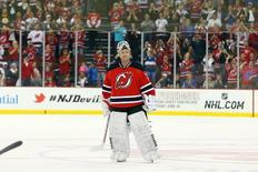 Apr 13, 2014; Newark, NJ, USA; New Jersey Devils goalie Martin Brodeur (30) is honored by fans after his 3-2 win over the Boston Bruins at Prudential Center.  Mandatory Credit: Ed Mulholland-USA TODAY Sports
