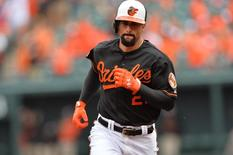 Oct 3, 2014; Baltimore, MD, USA; Baltimore Orioles right fielder Nick Markakis (21) rounds the bases after hitting a two-run home run against the Detroit Tigers during the third inning of game two of the 2014 ALDS playoff baseball game at Oriole Park at Camden Yards. Mandatory Credit: Tommy Gilligan-USA TODAY Sports