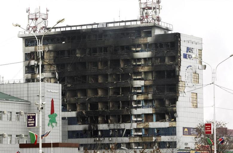 The burnt exterior of the Press House, a local media agency, is seen in the Chechen capital Grozny, December 4, 2014. REUTERS/Stringer