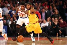 Cleveland Cavaliers point guard Kyrie Irving (2) and New York Knicks shooting guard Iman Shumpert (21) chase after a loose ball during the fourth quarter at Madison Square Garden. Mandatory Credit: Brad Penner-USA TODAY Sports