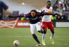New England Revolution midfielder Jermaine Jones (13) and New York Red Bulls midfielder Lloyd Sam (10) battle for the ball during the first half of the Eastern Conference Championship at Gillette Stadium. Nov 29, 2014; Foxborough, MA, USA;  Winslow Townson-USA TODAY Sports -