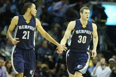 Memphis Grizzlies forwards Tayshaun Prince (21) and Jon Leuer (30) celebrate after a score by Leuer in the second half against the Miami Heat at FedExForum. Memphis defeated Miami 103-87. Mandatory Credit: Nelson Chenault-USA TODAY Sports