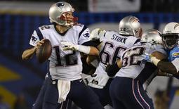 New England Patriots quarterback Tom Brady (12) throws a pass during the third quarter against the San Diego Chargers at Qualcomm Stadium. Mandatory Credit: Robert Hanashiro-USA TODAY Sports