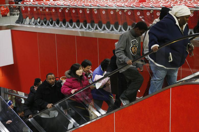 Thanksgiving Day shoppers ride an escalator while shopping at a Target store in Chicago, November 27, 2014. REUTERS/Andrew Nelles