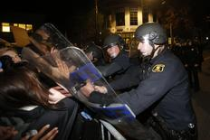 Police officers with the Berkeley Police Department clash with protesters during a march against the New York City grand jury decision to not indict in the death of Eric Garner in Berkeley, California December 8, 2014.  REUTERS/Stephen Lam