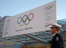 A Monaco's policeman stands in front of the Grimaldi Forum during the opening of the 127th International Olympic Committee (IOC) session in Monaco December 8, 2014.  REUTERS/Eric Gaillard