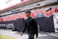 Sep 7, 2014; Tampa, FL, USA; Carolina Panthers quarterback Cam Newton (1), who was declared inactive due to an injury, walks onto the field before the game against the Tampa Bay Buccaneers at Raymond James Stadium. David Manning-USA TODAY Sports