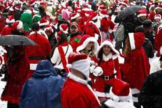 Revelers dressed as Santa Claus gather at a park during the SantaCon event in New York December 14, 2013. REUTERS/Eduardo Munoz