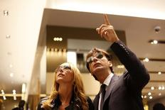 Designer Frida Giannini (L) chats with Gucci CEO Patrizio Di Marco at the new Gucci flagship store on its opening day in Shanghai in this file photo taken on June 6, 2009. REUTERS/Nir Elias