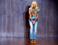 Kering a annoncé vendredi le départ de Patrizio di Marco, PDG de Gucci, sa marque de luxe italienne, ainsi que de Frida Giannini, la directrice de la création qui est également la compagne du dirigeant, le groupe français confirmant ainsi une information du New York Post. /Photo prise le 17 septembre 2014/REUTERS/Stefano Rellandini