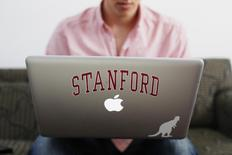 Chris Barber, a student at Stanford University, uses a laptop computer as he conducts business from his dorm room in Stanford, California, June 11, 2014. REUTERS/Beck Diefenbach