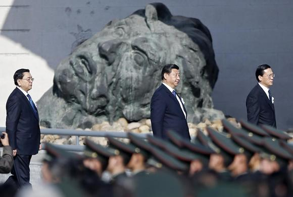 Chinese President Xi Jinping (C) and other leaders attend a memorial ceremony at the Nanjing Massacre Museum in Nanjing, Jiangsu province December 13, 2014. REUTERS/Aly Song