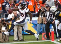 Dec 14, 2014; San Diego, CA, USA; Denver Broncos wide receiver Demaryius Thomas (88) scores on a 28-yard pass play from quarterback Payton Manning in the third quarter against the San Diego Chargers at Qualcomm Stadium. Right is San Diego Chargers defensive back Jahleel Addae (37). The Broncos went on to a 22-10 win. Mandatory Credit: Robert Hanashiro-USA TODAY Sports