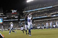 Dallas Cowboys wide receiver Dez Bryant (88) catches a touchdown pass in front of Philadelphia Eagles cornerback Bradley Fletcher (24) in the first quarter at Lincoln Financial Field. Mandatory Credit: Eric Hartline-USA TODAY Sports