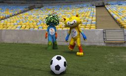The mascots of the Rio 2016 Olympic (R) and Paralympic Games are pictured during a visit at the Maracana Stadium in Rio de Janeiro December 4, 2014. REUTERS/Ricardo Moraes