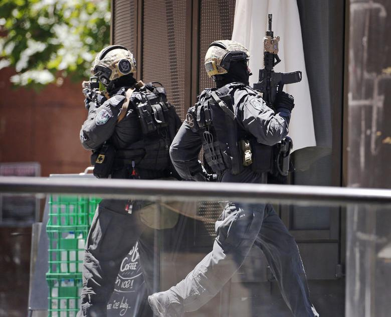 Police storm Sydney cafe to end hostage siege, three...