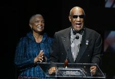 Comedian Bill Cosby addresses the crowd in front of his wife, Camille Cosby, after being honored during the Apollo Theatre's 75th anniversary gala in New  York, in this June 8, 2009 file photo.  REUTERS/Lucas Jackson
