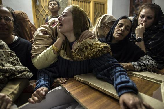 A mother mourns her son Mohammed Ali Khan, 15, a student who was killed during an attack by Taliban gunmen on the Army Public School, at her house in Peshawar December 16, 2014. REUTERS/Zohra Bensemra