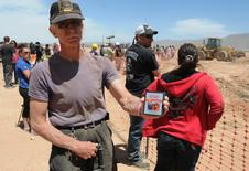 "Randy Horn shows his personal copy of ""E.T. the Extra-Terrestrial"" at the old Alamogordo Landfill dig site in Alamogordo, New Mexico, in this file photo taken April 26, 2014. REUTERS/Mark Wilson/Files"