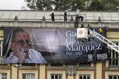 Workers install a banner of the late Nobel Laureate Gabriel Garcia Marquez in Bogota April 22, 2014. REUTERS/Fredy Builes