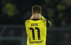 Jogador do Borussia Dortmund Marco Reus reage durante primeira partida contra o Real Madrid pelas quartas de final da Liga dos Campeões da Europa, em Dortmund. 8/10/2014. REUTERS/Ina Fassbender/Files