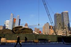 A man passes by the still unfinished 34th St. Hudson Yards stop for the Number 7 subway line in New York December 12, 2014.  REUTERS/Brendan McDermid
