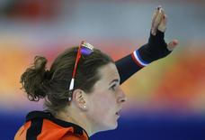 Irene Wust of the Netherlands waves after the women's 1,000 metres speed skating race at the Adler Arena during the 2014 Sochi Winter Olympics February 13, 2014. REUTERS/Issei Kato