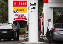 People refuel their vehicles at a Petro-Canada gas station in Toronto, June 23, 2014. REUTERS/Mark Blinch